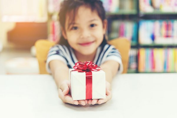 child giving a gift
